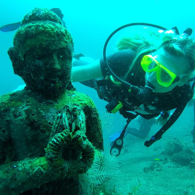 Another shot from diving up in Tulamben - Tara checking out some of the underwater sculptures sunk to promote coral growth just off the shoreline
